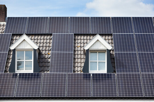 Alternative energy from solar panels on a roof with two dormers