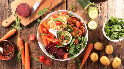 buddha bowl- mixed vegetable salad with beetrool, carrot, sweet potato, lettuce, cereals and...