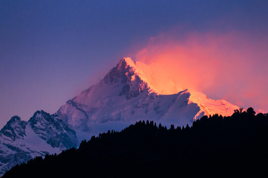 The majestic Kanchenjunga range of the himalayas at first light of sunrise at Sikkim , India