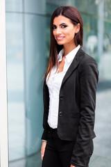 Smiling businesswoman poirtrait in a confident expression outdoor