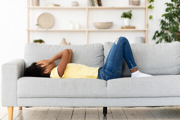 Frustrated Black Girl Crying Covering Face Lying On Couch Indoor