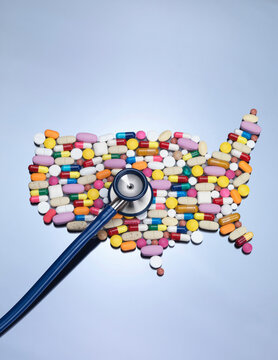 Stethoscope on pills in USA shape