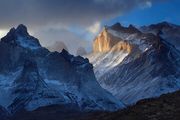 View of storm clouds over snow capped mountains, Torres Del Paine National Park, Chile