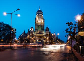 Exterior of Mumbai Municipal Corporation building at evening rush hour, Mumbai, India