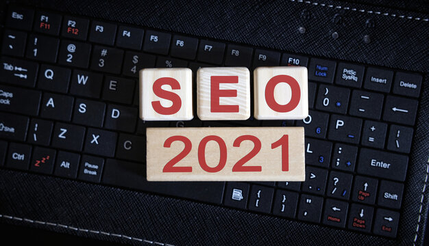 SEO 2021 concept. Wooden cubes on a black keyboard