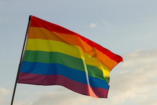 LGBT flag on sky background