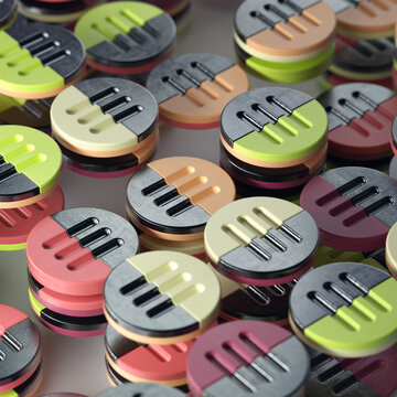 Colorful plastic and metal discs stacked in rows