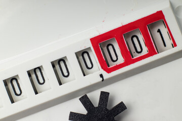 Indicator with numbers of a mechanical counter. Counting to one