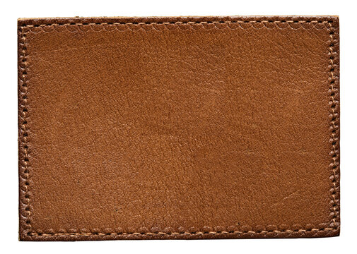 Blank brown leather label, macro close up. Leather patch with stitching