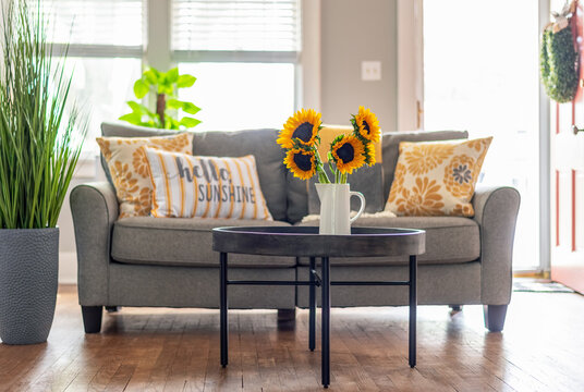 Bright sunny living room with sunflowers on the coffee table