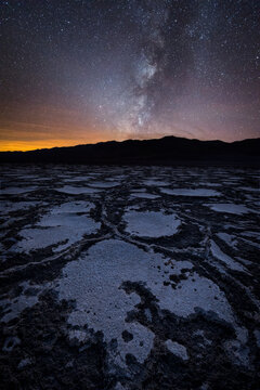 Scenic view of salt flat at Death Valley with milky way in sky