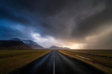 View of empty road against stormy clouds