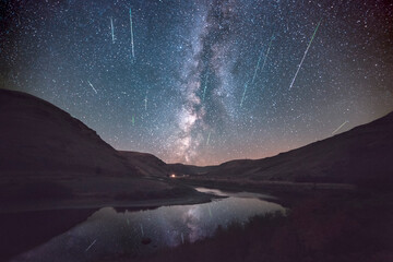 Milky Way and Meteor shower reflecting in John Day River in Cottonwood Canyon State Park