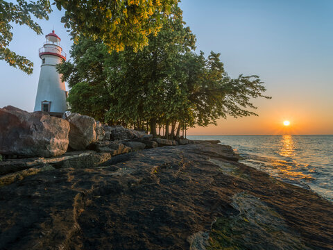 View of Marblehead Lighthouse by sea during sunset
