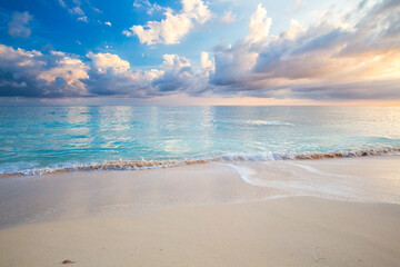 White sand beach during sunrise