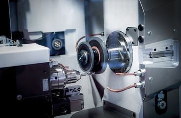 CNC tool grinding machines for indexable cutting inserts and rotationally symmetrical tools. Fotobehang