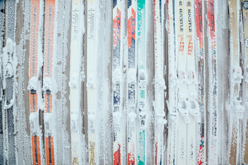 Snow covered skis mounted to wall of Corbet's Cabin