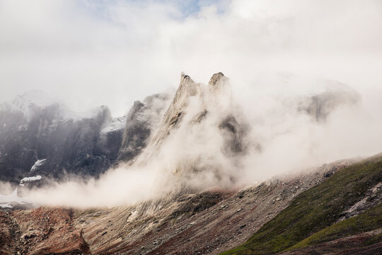 Scenic view of mountain surrounded by clouds