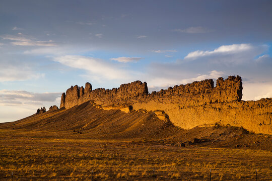 View of rock formations against cloudy sky during sunset