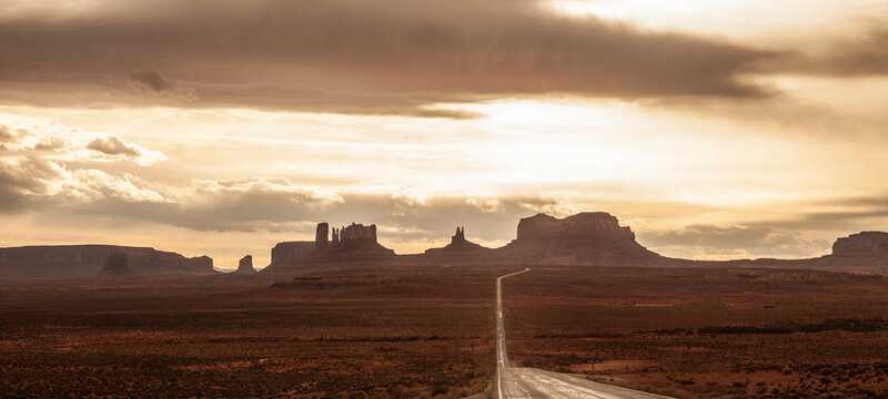 View of empty highway leading to Monument Valley
