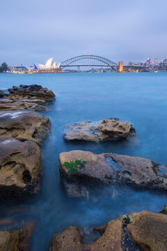 View of Sydney Opera House and Sydney Harbor Bridge at dusk
