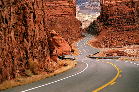 Empty road winding through mountains