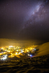 View of Huacachina village against starry sky at night
