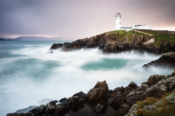 View of Fanad Head Lighthouse on rocky coast