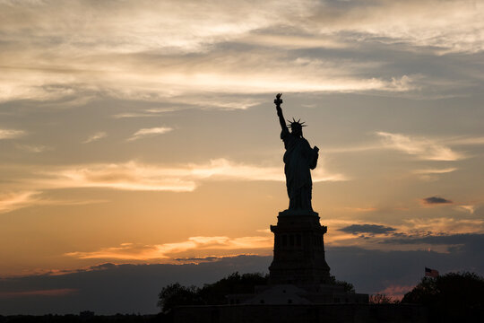View of Statue of Liberty against cloudy sky during sunset