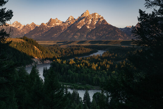 Scenic view of Snake River with mountains in background