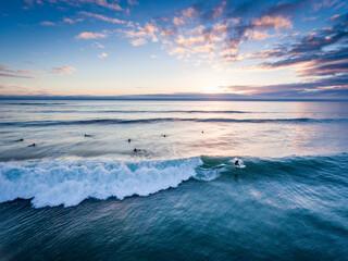 Men surfing in sea