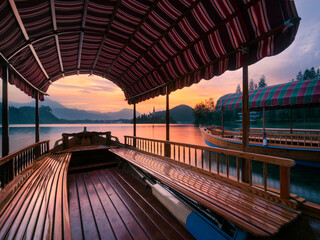 Scenic view of Pletna boat in Lake Bled during sunrise