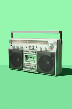Retro Vintage 80's Boom Box Cassette Player Stereo Portable Music System on Green Background Dark Shadow