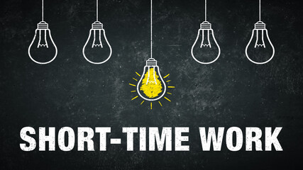 Term Short-time work on a rustic background with 5 light bulbs.