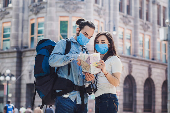 latin young people tourists with face mask on vacation in Mexico Latin America in coronavirus pandemic