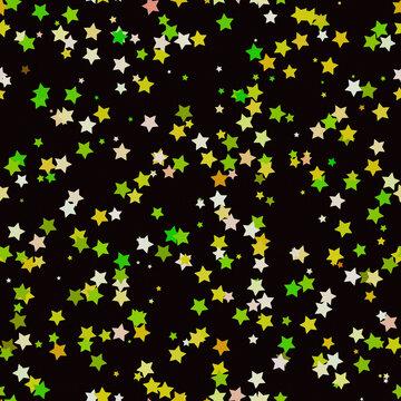 Cartoon yellow green overlapping stars on black background. Seamless kids birthday or Christmas design.