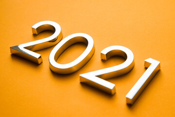 Close-up of metal numbers 2021 on orange background