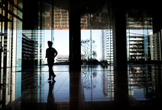 A security personnel walks as the entrance hall of SoftBank's new headquarters building in Tokyo
