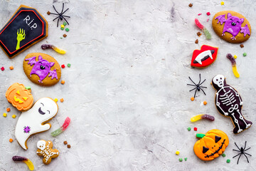 Set of Halloween cookies with candies flat lay, overhead view