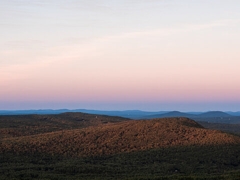 Watching the sunset on southern New Hampshire while descending North Pack Monadnock in Greenfield.