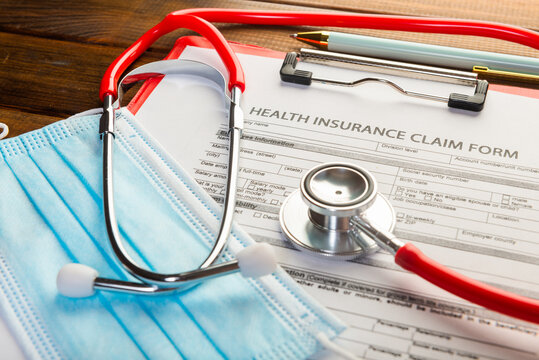 Health insurance claim form with surgical mask