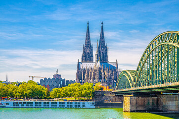 Cologne cityscape of historical city centre with Cologne Cathedral Roman Catholic Church of Saint Peter gothic style building, Hohenzollern Bridge across Rhine river, North Rhine-Westphalia, Germany