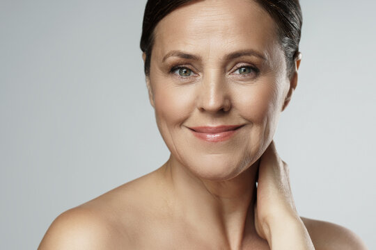 Beautiful middle aged woman with clean wrinkled skin