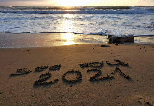 New Year 2021 is coming, message see you 2021 on a beach sand, Summer beach holiday 2020 season is over, copy space