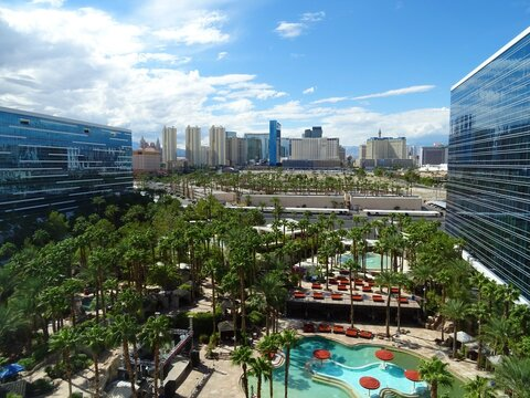 Las Vegas skyline view from Hardrock hotel with blue sky and clouds, pool, trees September 2018