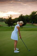 Professional Golfer Woman Focused On Hitting Ball .