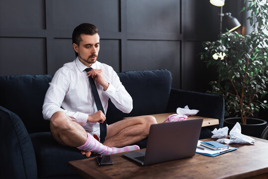Businessman without pants during job interview or online meeting during distant work from home