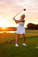 Active Female Hit Ball at Golf Course .
