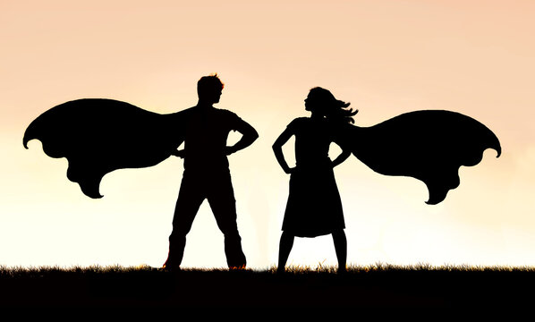 Silhouette of SuperHero Man and Woman Couple in Capes Standing Strong