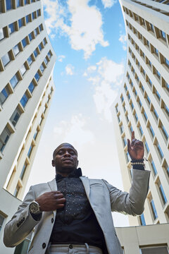 African American businessman between buildings